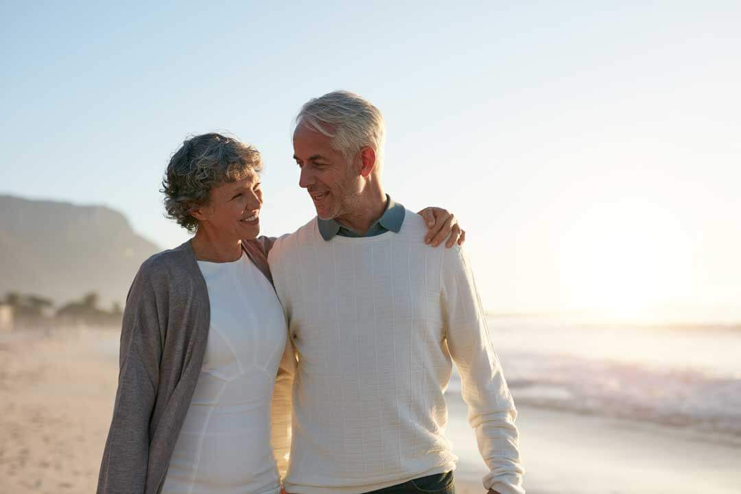 couple on beach; understanding Medicare supplements